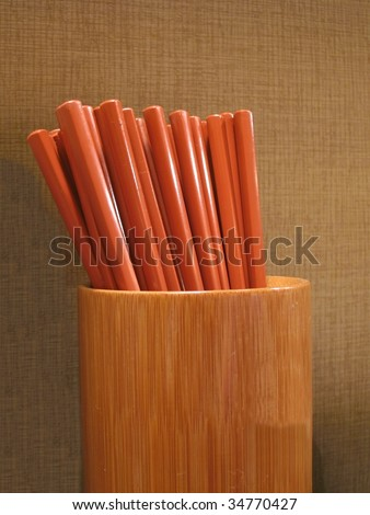 A bundle of chopsticks in a bamboo holder in a Japanese restaurant