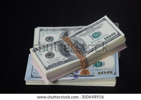 a bundle of money tied with gold chain