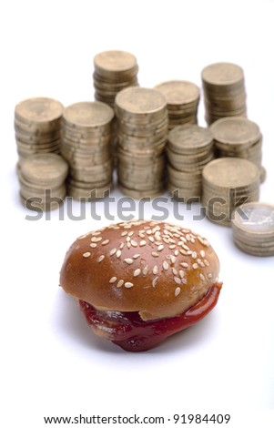 a burger with some money behind - stock photo