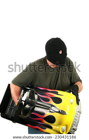 A Burglar with a black ski mask and black gloves isolated on white. Burglars like to break into other peoples houses and buildings to steal their money and valuables when they are not home. Bad Guy   - stock photo