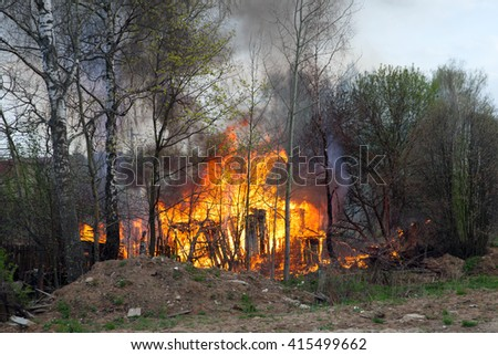 A burning house in spring forest