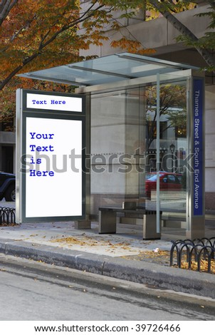 A bus stop with the advertisement isolated in white - stock photo