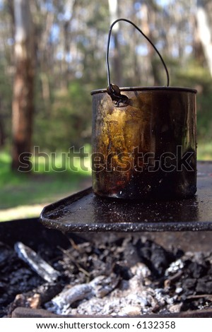A bush campfire, with a billy boiling on the hot plate. - stock photo