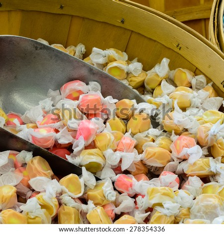A bushel of mixed taffy candy with scoop in it in a local market at Ellensburg, Washington, US - stock photo