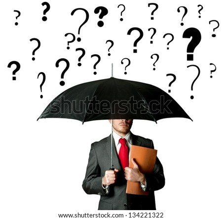 A businbessman protects himself by doubts with umbrella - stock photo