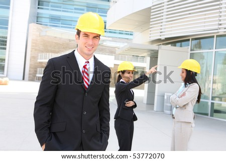 A  business construction man and woman team at work site