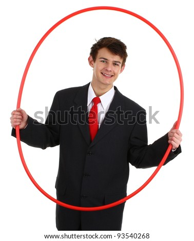 A business guy holding a hoop about to go through it, isolated on white - stock photo