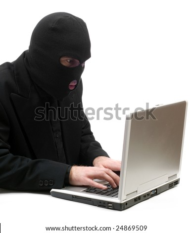 A business hacker is breaking into a laptop computer and stealing information, isolated against a white background - stock photo