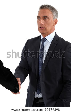 A business handshake - stock photo