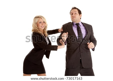 A business man and woman pushing and trying to get there first. - stock photo