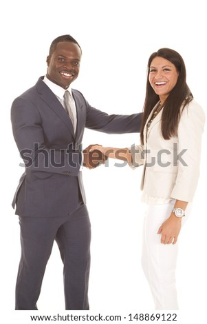 A business man and woman shaking hands with smiles on their faces. - stock photo
