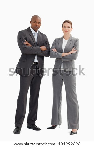 A business man and woman with their hands crossed - stock photo
