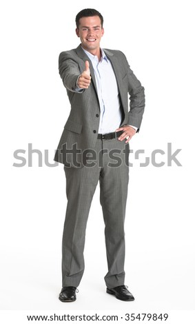 A business man displaying a 'thumbs up' gesture.  He is smiling directly at the camera.  Vertically framed shot.