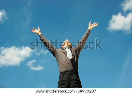 A business man freeing himself from his work load - stock photo