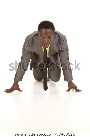 a business man getting ready for the race of the business world. - stock photo