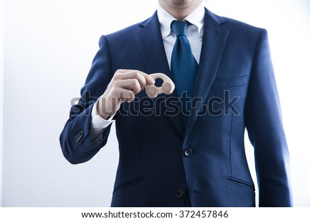 A business man holding a toy car
