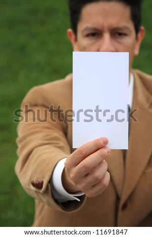 A business man holding a white card with copy-space - stock photo