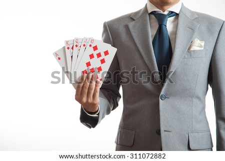 A business man holding cards