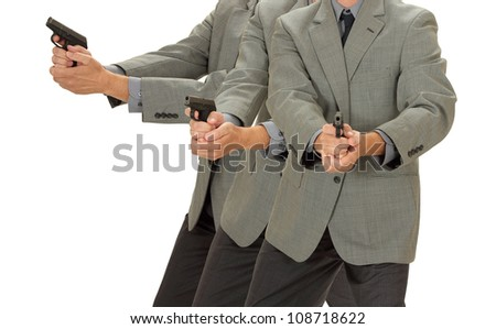 A business man holds a weapon isolated on white