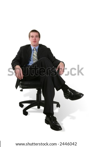 A business man in a business chair isolated over white
