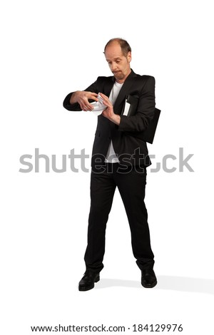 A Business man is doing some handicrafts with a paper on a white background. - stock photo