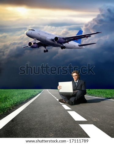 a business man on the street and  a airplane - stock photo