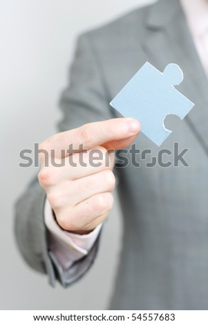 A business man solving a puzzle - stock photo