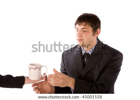 A business man taking a drink from someone. - stock photo