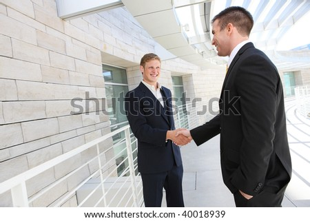 A business man team at office shaking hands