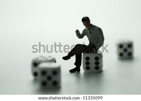 A business man thinking on dice. - stock photo
