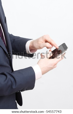 A business man typing on cell phone - stock photo