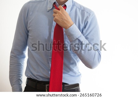 A business man wearing off his necktie