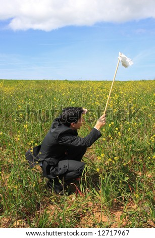 A business man with a white flag giving-up - stock photo