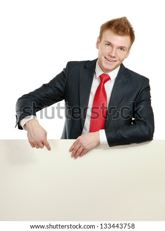 A business man with an empty blank, isolated on white background