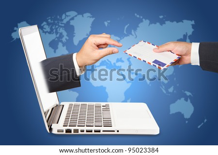 A business people hand holding air mail with  hand concept of receiving a message through a laptop