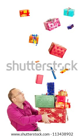 A business person catching a lot of gifts - stock photo