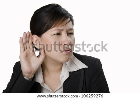 a business person try to listen to something