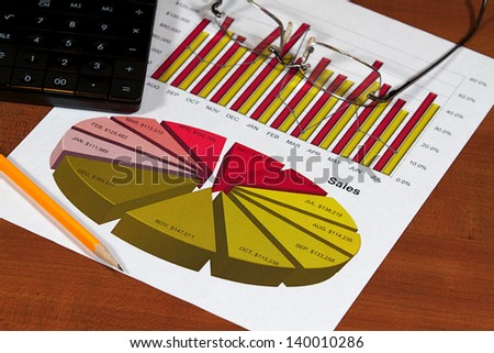 A business plan and project on a desk top - stock photo