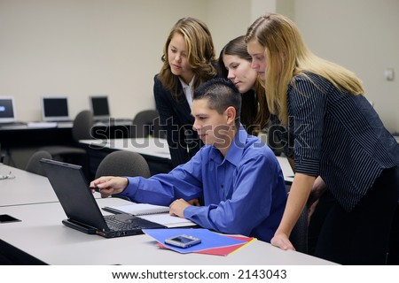A business team gathered around the computer (Focus on Man)