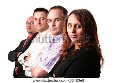 A business team of four isolated on a white background. Focus on the front woman - stock photo