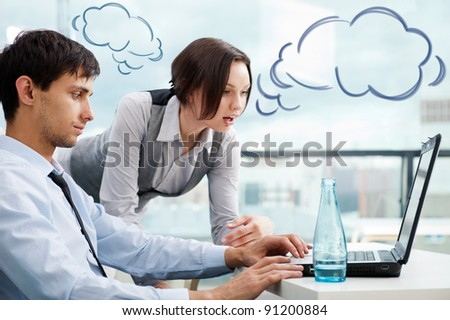 A business team of two colleagues planning work in office. Blank cloud balloons of their dialog for your text and logo - stock photo