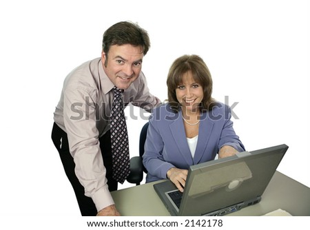 A business team working together on a laptop computer.  Isolated on white.