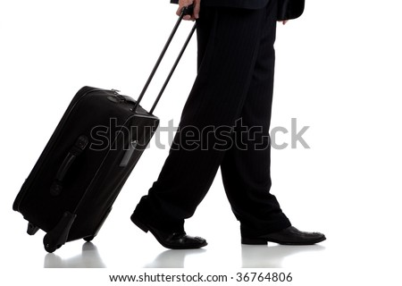 A business traveler or pilot with suitcase on white background - stock photo