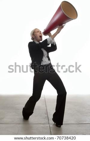 A business woman announces through a megaphone. - stock photo