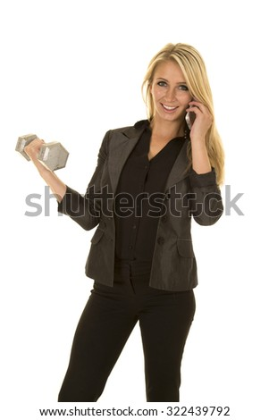 a business woman doing work and being healthy at the same time. - stock photo