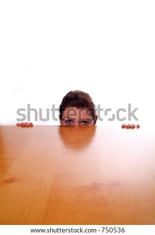 A business woman hiding behind a desk.