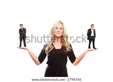a business woman is holding two businessman in her hands - stock photo