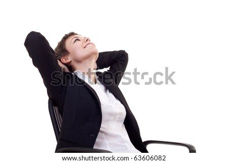A business woman leaning back in a black chair dreaming - stock photo