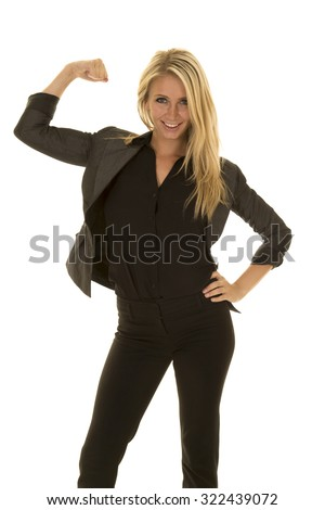 A business woman ready for work, showing her power by flexing her arms.