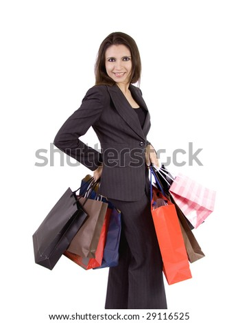 A business woman who is very pleased because she has done a lot of shopping